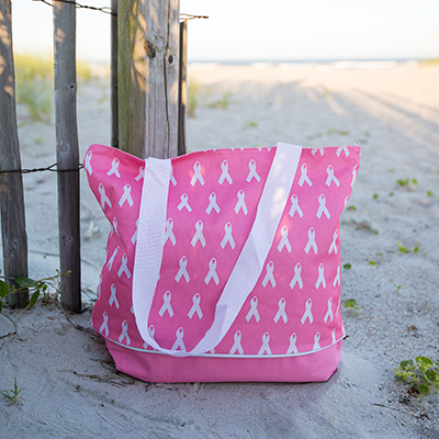 NAVIGATOR<sup>®</sup> Pink Tote - This handy tote features a zippered top closure and measures 12