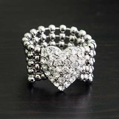 GUESS<sup>®</sup> Stretch Pavé Heart Ring - This cute silver-tone band features a pavé crystal heart. Ring is nickel and lead free with a stretch band that fits up to size 7-8.