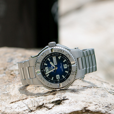 REACTOR<sup>&reg;</sup> Critical Mass Degrading Blue Dial Stainless Steel Men's Watch - Built for durability, strength and style, this watch has a striking blue dial and handsome stainless steel band.  Features day/date display, Japanese quartz movement, unidirectional rotating bezel, marine-grade 316L  stainless steel case and caseback.  Water resistant up to 660 meters. Superluminova on hands and markers.